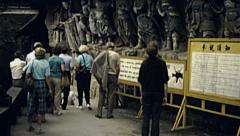 Chongqing, China 1987: visitors at Dazu Rock Carvings Stock Footage