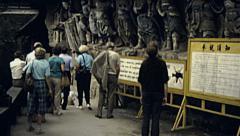 Chongqing, China 1987: visitors at Dazu Rock Carvings Stock Footage