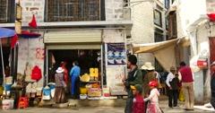 4k tibetan & tourist walking on famous barkhor street in lhasa,tibet,butter sto Stock Footage
