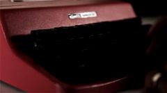 Typing on red typewriter Stock Footage