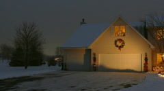 Home With Festive Christmas/Holiday Outdoor Lighting and Snow Stock Footage