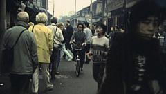 China 1987: crowd in an outdoor market Stock Footage