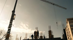 Few Workers Building Construction Site Crane Forming Reduced Color Stock Footage