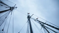 rigging and ropes against stormy sky - stock footage