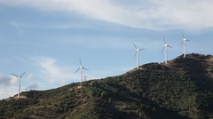 Wind farm on a windy hill Stock Footage