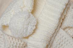 Knitted texture and color of ivory bubo Stock Photos