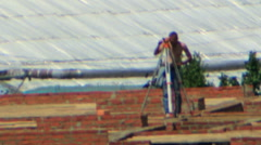 Worker in heat haze Stock Footage