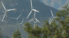 WINDMILLS TURNING IN THE WIND Stock Footage