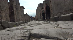 Naples Italy Pompeii tourists walking along ancient road 4K 027 Stock Footage