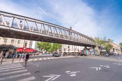 Paris, france - june 20, 2014: tourists wal along city streets on a sunny day Stock Photos
