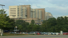 Establishing shot: University of Michigan Hospital and traffic HD Stock Footage