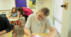 Teacher helping students with their school assignments and homework. Ultra HD 4K - stock footage