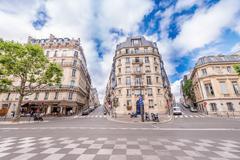Paris - june 12, 2014: tourists walk ain avenue kleber. paris is visited by m Stock Photos