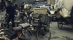 China 1987: bike vans in an outdoor market Stock Footage