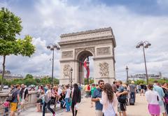 paris, france - june 20, 2014: tourists enjoy triumph arc view on a sunny day - stock photo