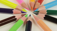 Colored pencil turning on a white background, closeup rotating Stock Footage