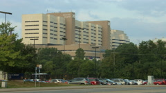 Establishing shot: University of Michigan Hospital and traffic 4K Stock Footage