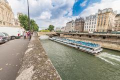 Stock Photo of paris - june 19, 2014: bateau mouche on the river. bateaux mouches are open e