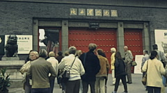 China 1987: visitors entering into an old palace Stock Footage