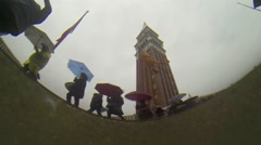 Rising seas: tourists seen from below high water level, venice, italy - slow mo Stock Footage