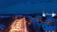 night time winter traffic time lapse in Reykjavik,  Iceland near church 4k - stock footage