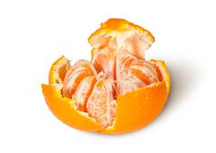 Partially purified and broken tangerine Stock Photos