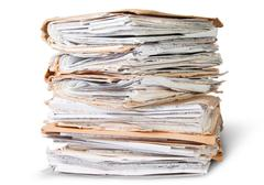 Old files stacking up in a messy order Stock Photos