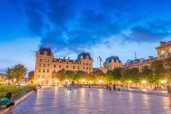 Stock Photo of paris - june 21, 2014: tourists enjoy summer night lights in the square of no