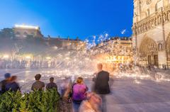 Paris - june 21, 2014: tourists enjoy summer night lights show in the square  Kuvituskuvat