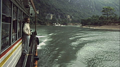 China 1987: man watching panorama during a boat trip on the Yangtze river Stock Footage