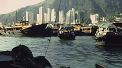 Hong Kong 1987: boat trip in front of the city - stock footage