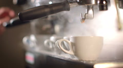Preparing cups of espresso at a busy coffee shop - stock footage