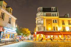 Paris, france - june 20, 2014: tourists enjoy montmartre city life on a beaut Stock Photos