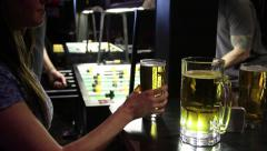 Woman drinking and watching Table soccer at a sports bar Stock Footage