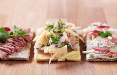 crispbread with various toppings - stock photo