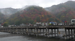 Moon Crossing Bridge in Arashiyama, Kyoto, Japan Stock Footage