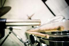 professional microphone placed close to drums with sticks - stock photo