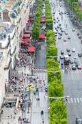 Paris, france - july 20, 2014: tourists walk along champs elysees on a summer Stock Photos
