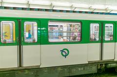 Paris - july 21, 2014: metro train speeds up in subway station. subway system Kuvituskuvat