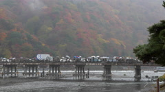 Fall Color and Moon Crossing Bridge in Arashiyama, Kyoto, Japan Stock Footage