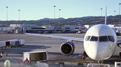 Plane workers on the runnaway, San Francisco - 1080p Stock Footage