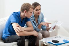 poor marriage reading unpaid bills - stock photo