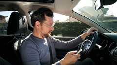 Funny man texting message with cell phone while driving Stock Footage