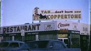 Stock Video Footage of Coppertone Suntan Lotion Sign Old Las Vegas 1960s Vintage Film Home Movie  8125