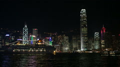 Ship sailing across Hong Kong Victoria Habour at night Stock Footage