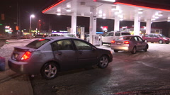 Cars line up for cheap gas in Canada Stock Footage