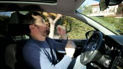 Happy crazy man dancing in car funny Stock Footage
