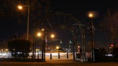 city park at night. motion time lapse. cars traffic lights background - stock footage