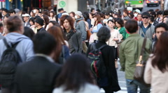 TOKYO, JAPAN - CIRCA 2013: Large crowds of pedestrians, commuters, and shoppers  Stock Footage