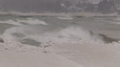 Huge waves breaking in blizzard on cold windy winter day Stock Footage